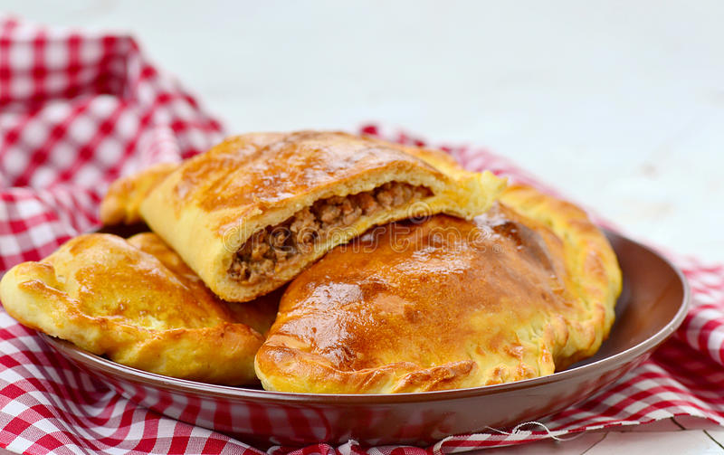 Calzone. The traditional Italian closed meat pizza royalty free stock image
