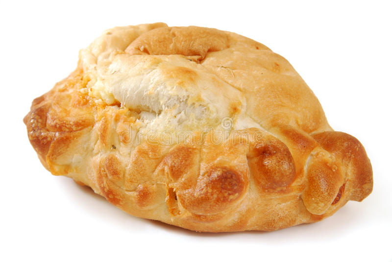 Calzone on white. A golden baked calzone on a white background royalty free stock photo
