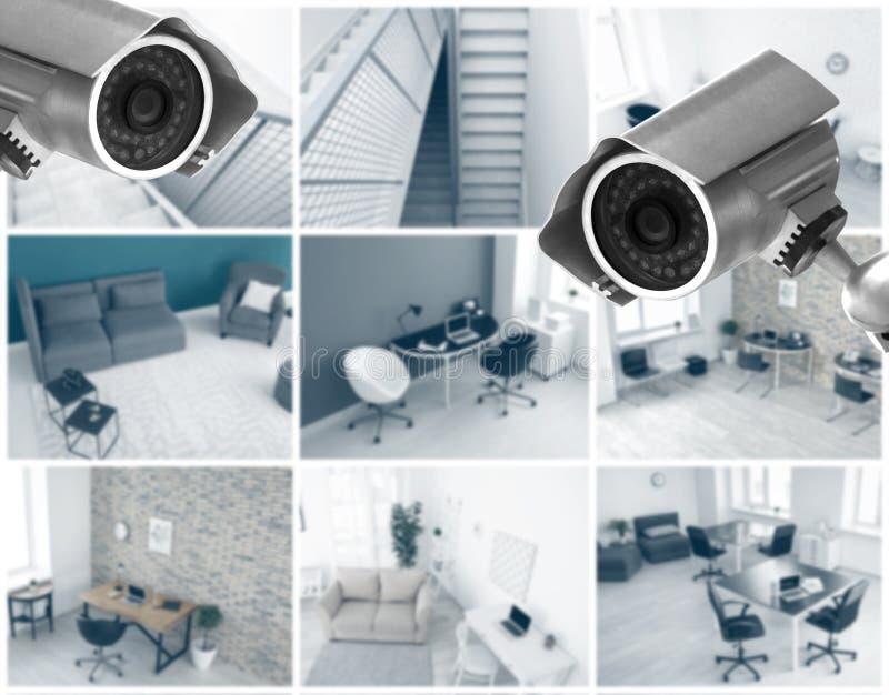 Caméras modernes de télévision en circuit fermé avec la vue brouillée des emplacements de bureau photographie stock
