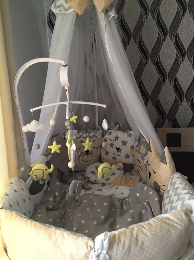 Cama de bebé imagen de archivo libre de regalías