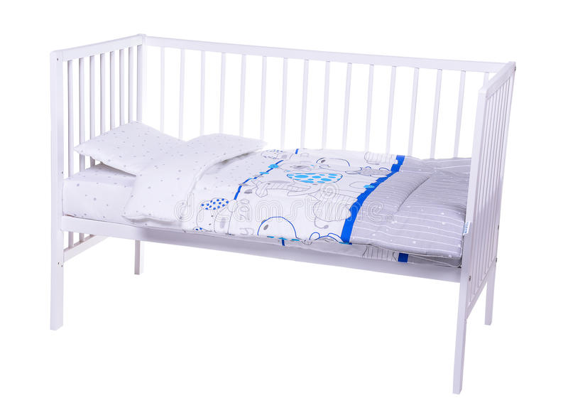Cama de bebê em um branco imagens de stock