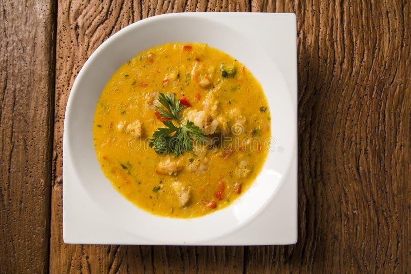 Camarão Bobo - um prato brasileiro do camarão em um puro da refeição da mandioca e do leite de coco fotos de stock royalty free