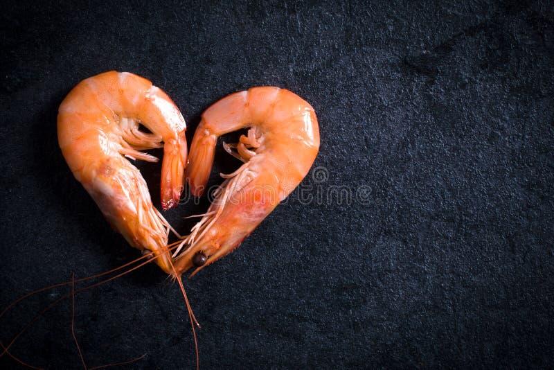 Camarões da forma do coração fotos de stock