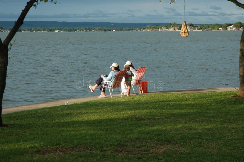Camaradas da pesca no lago fotografia de stock royalty free