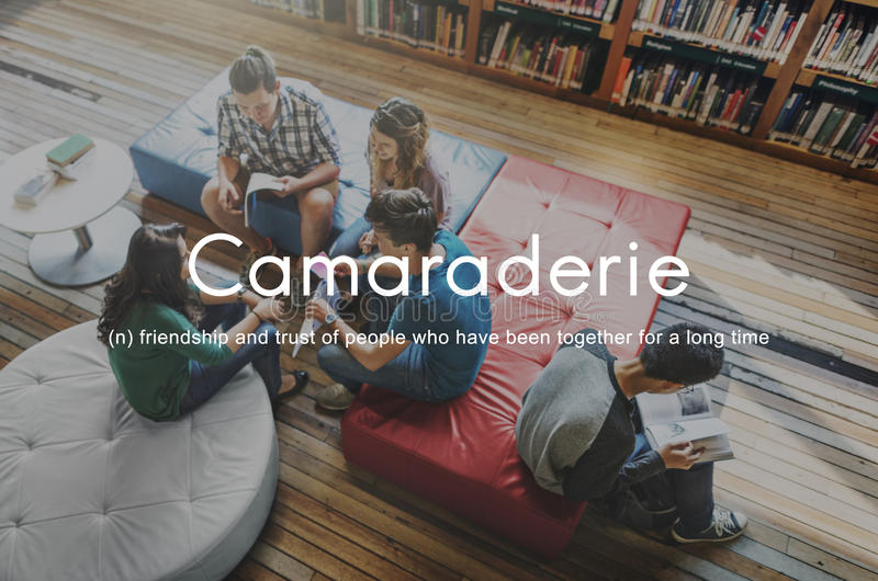 Camaraderie Carefree Chill Friends Togetherness Concept. Friends reading books in library stock photo