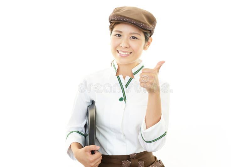 Camarera sonriente foto de archivo