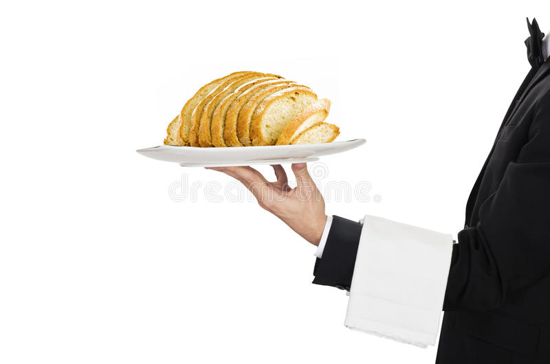 Camarero con pan cortado imagen de archivo
