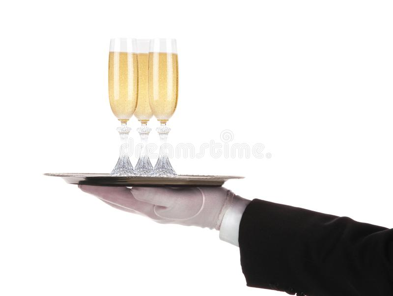 Camarero con tres vidrios del bulbo del champán en la bandeja aislada en blanco foto de archivo