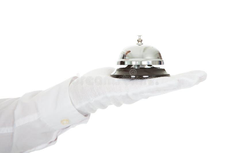 Camarero Holding un servicio Bell a disposición imágenes de archivo libres de regalías