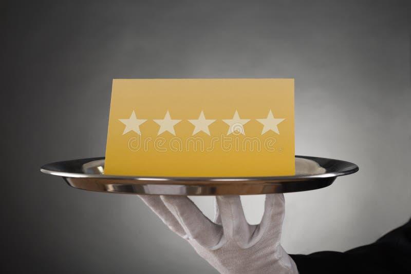 Camarero Serving Star Rating fotografía de archivo
