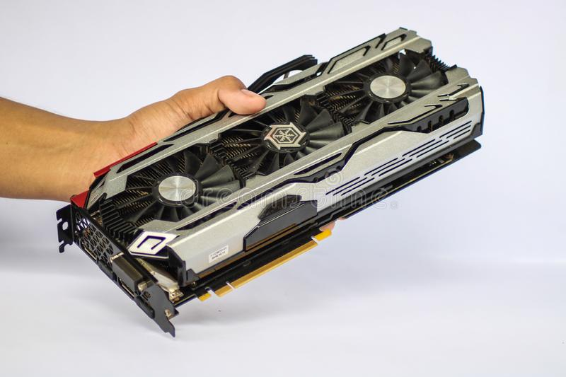 A hand holding a used ICHILL GEFORCE GTX 1080 X4 showing the front part of the Graphics Card Unit GPU. CAMARINES SUR, PHILIPPINES - OCT 28, 2018: A hand holding royalty free stock photography