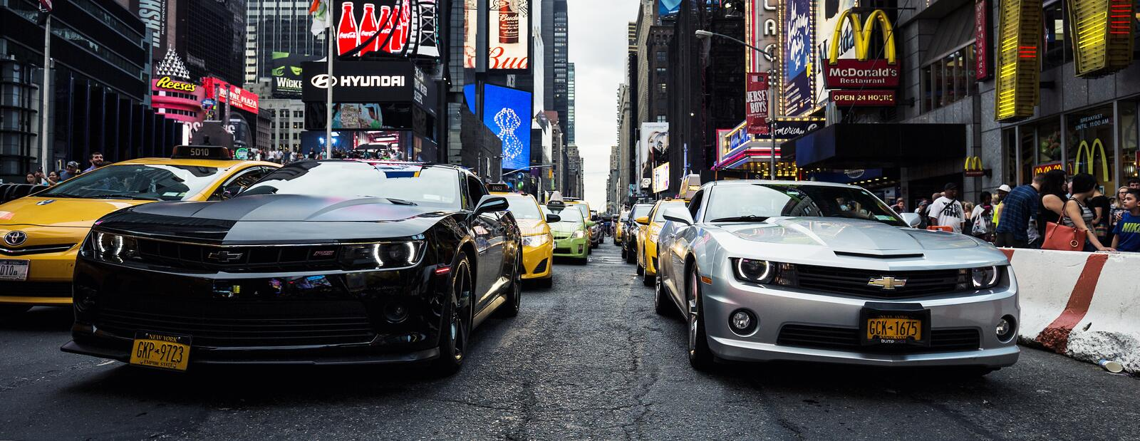 Camaros on Time Square. NEW YORK CITY -JULY 9: Times Square, featured with Broadway Theaters and animated LED signs, is a symbol of New York City and the United stock photo