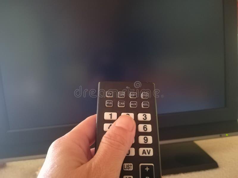Cambi il canale con il telecomando immagini stock