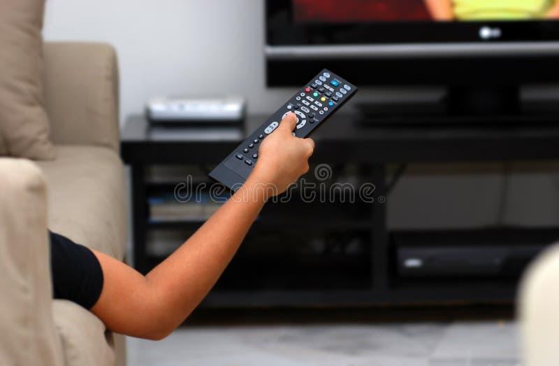 Cambi il canale televisivo fotografie stock