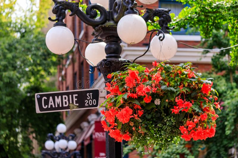 Cambie Street light and sign with flower basket in Gastown district of Vancouver in British Columbia Canada. Cambie Street light and sign with hanging flower stock photography