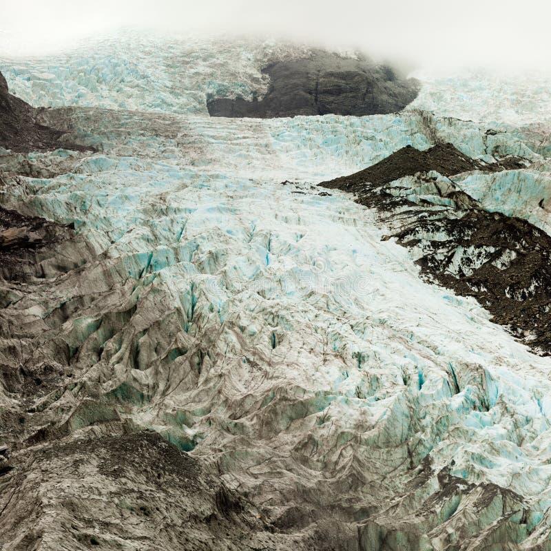 Cambio de clima, hielo del glaciar de fusión con las hendiduras imagen de archivo libre de regalías