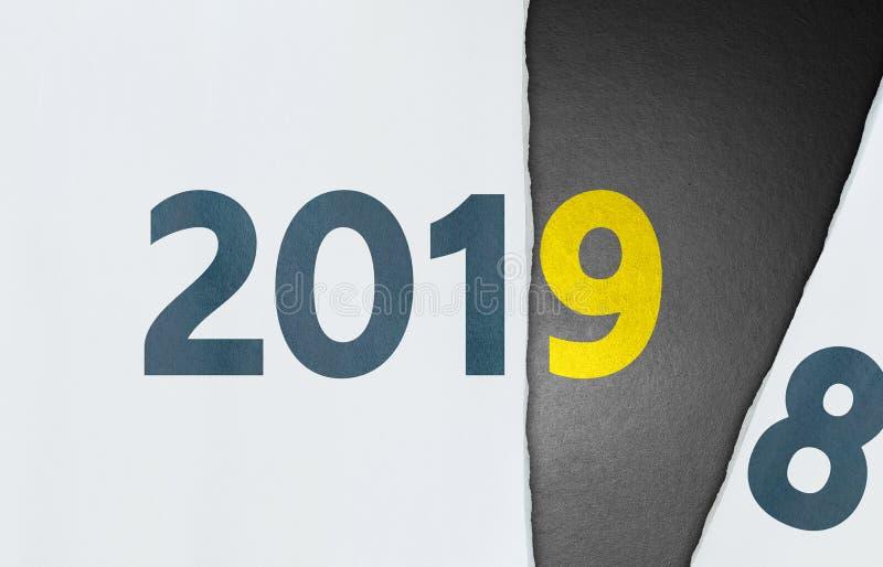 Cambio rasgado del papel a partir del año 2018 a 2019 foto de archivo