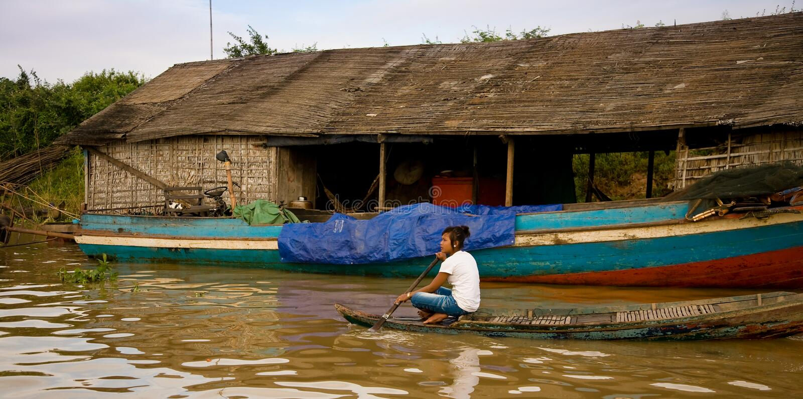 Cambodia. A girl in a boat in a floating village called Chong Khneas in Cambodia royalty free stock photo