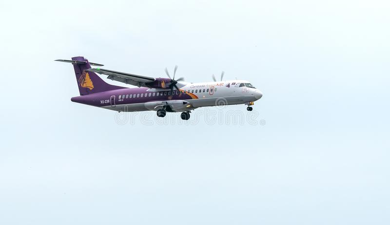 Cambodia angkor air atr 72 landing into Tan Son Nhat International Airport royalty free stock photography