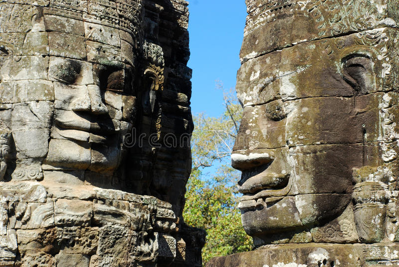 Smile face on Bayon temple. Cambodia, Angkor, stone smile face on Bayon Temple, side view stock photo
