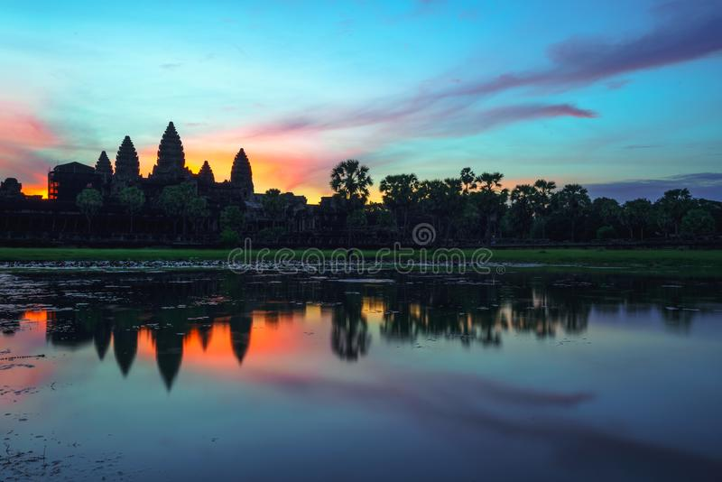 Cambodia Angkor Wat landmark with reflection in water. On sunrise royalty free stock photos