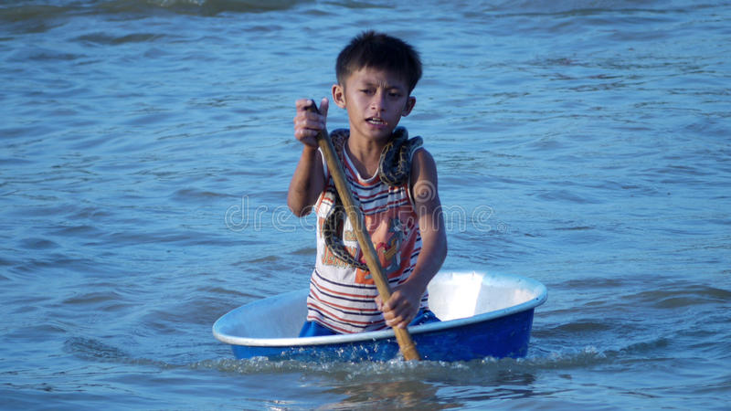 Download Cambodian Boy (with Snake) Paddling In A Basin Editorial Photography - Image: 19159287
