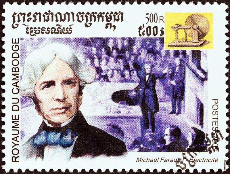 CAMBODIA - CIRCA 2001: En stämpel i Kambodja från 'Millennium'-frågan visar Michael Faraday, elmotor, runt 2001. royaltyfria bilder