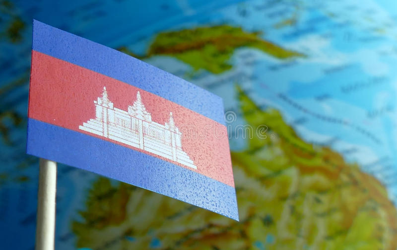 Cambodia flag with a globe map as a background royalty free stock photography