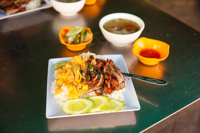 Cambodia Food. Cambodian food: Roast pork on the barbecue. Rice with scrambled eggs, soup and fresh vegetables. Cambodia, Siem reap stock images