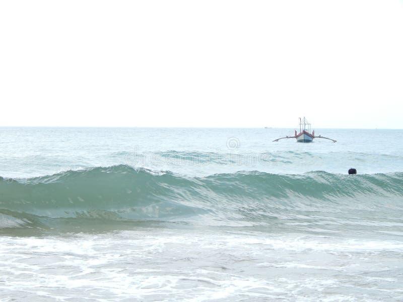 Cambodia, sea, waves, summer, fishing boat royalty free stock photography