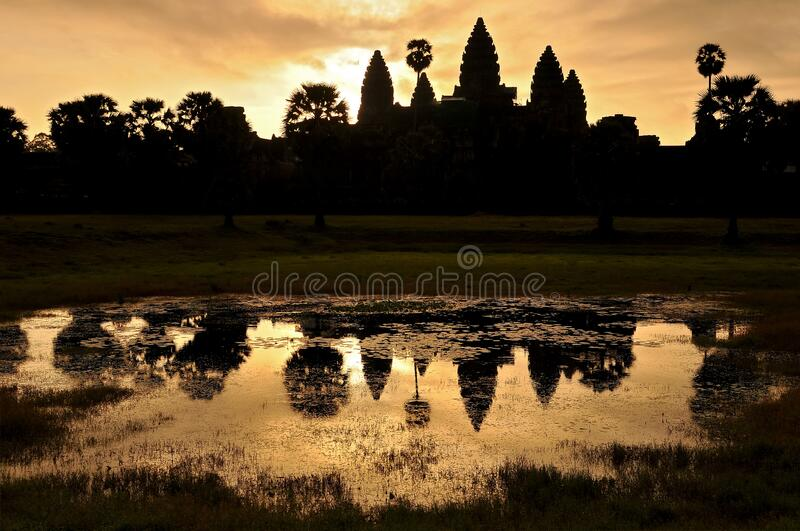 Cambodia, Siem Reap, Angkor Wat Temple silhouette with sunset sky.  royalty free stock photos