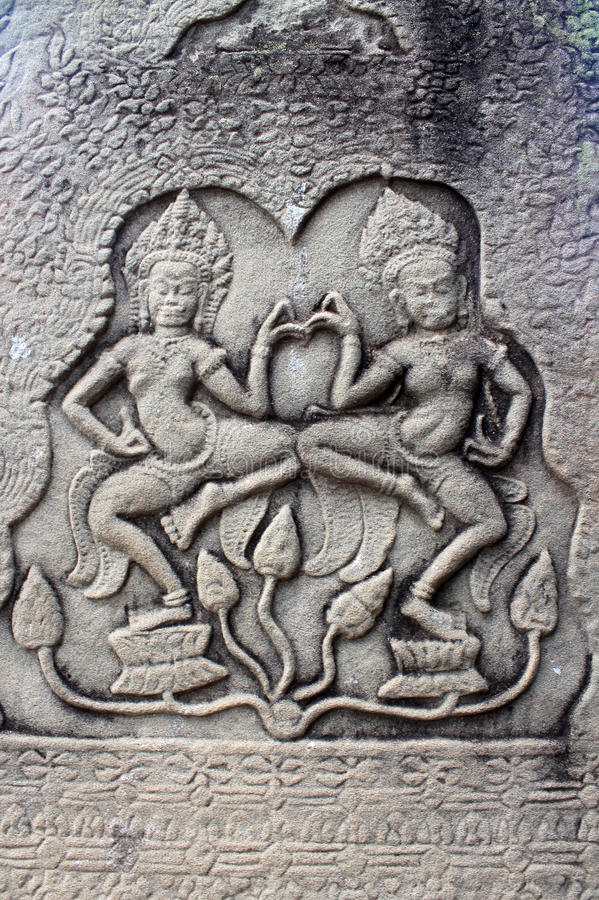 Cambodia Siem Reap Apsara dancers. The bas-relief on the wall of the temple dancer Apsara stock image