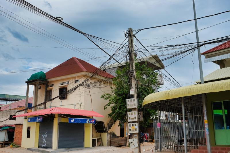 Cambodia, Siem Reap 08/12/2018 city communications, power lines, tangled electrical wires, a pole. Cambodia, Siem Reap 08/12/2018 city communications, power royalty free stock photography