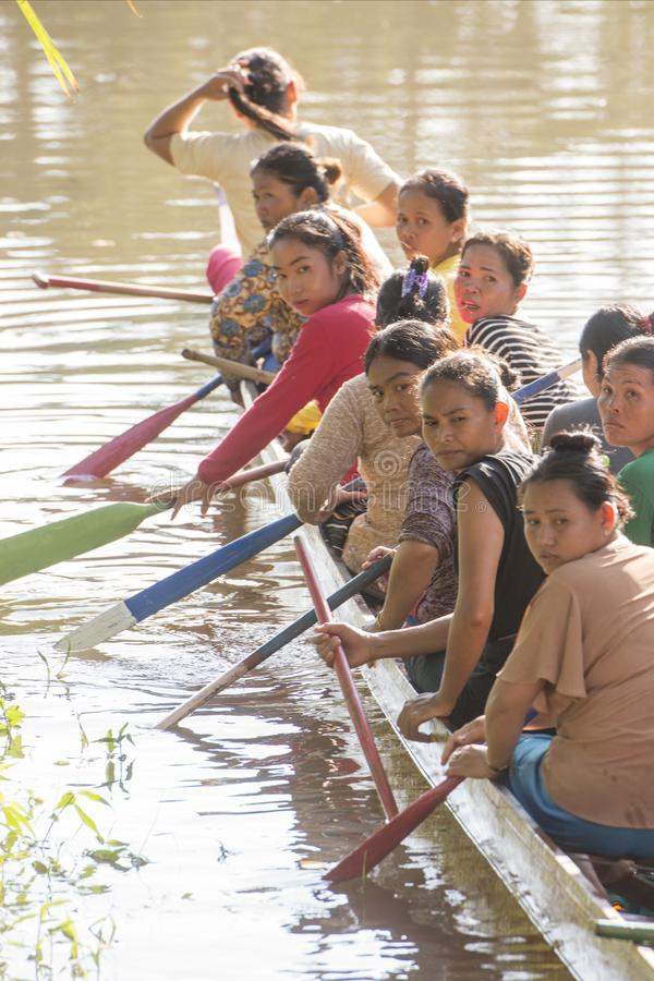 CAMBODIA SIEM REAP CITY RIVER LONGBOAT. Women at a training on a Longboat race at the Siem Reap River in the old Town in the city of Siem Reap in northwest of royalty free stock images