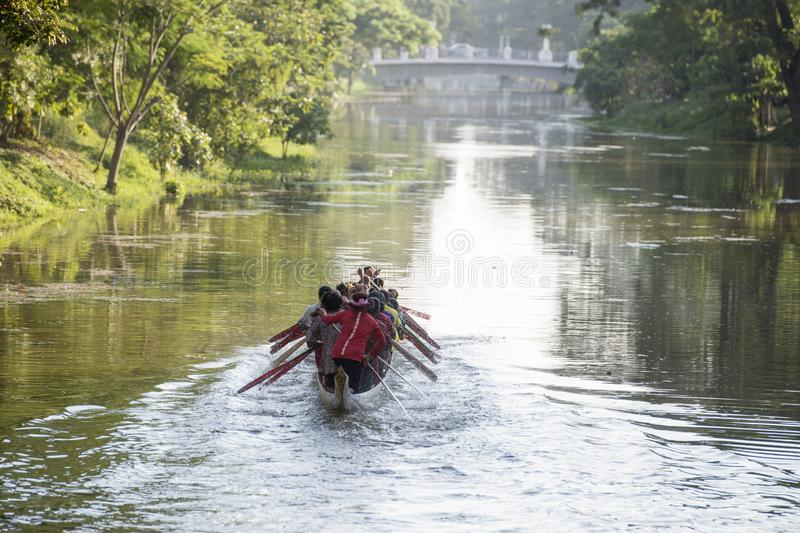 CAMBODIA SIEM REAP CITY RIVER LONGBOAT. Women at a training on a Longboat race at the Siem Reap River in the old Town in the city of Siem Reap in northwest of royalty free stock photo