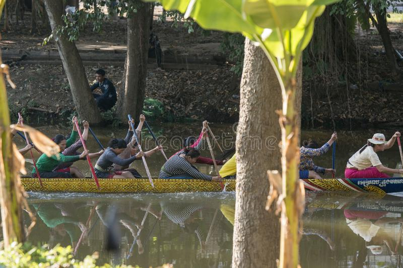 CAMBODIA SIEM REAP CITY RIVER LONGBOAT. Women at a training on a Longboat race at the Siem Reap River in the old Town in the city of Siem Reap in northwest of royalty free stock image