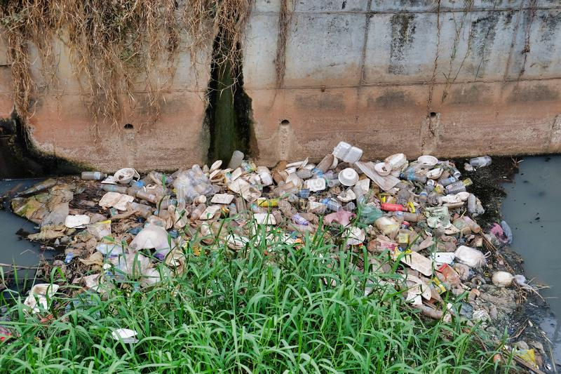 Cambodia, Siem Reap 12/08/2018 a garbage dump in a city water canal, a lot of garbage. Cambodia, Siem Reap 12/08/2018 garbage dump in a city water canal, a lot royalty free stock photo