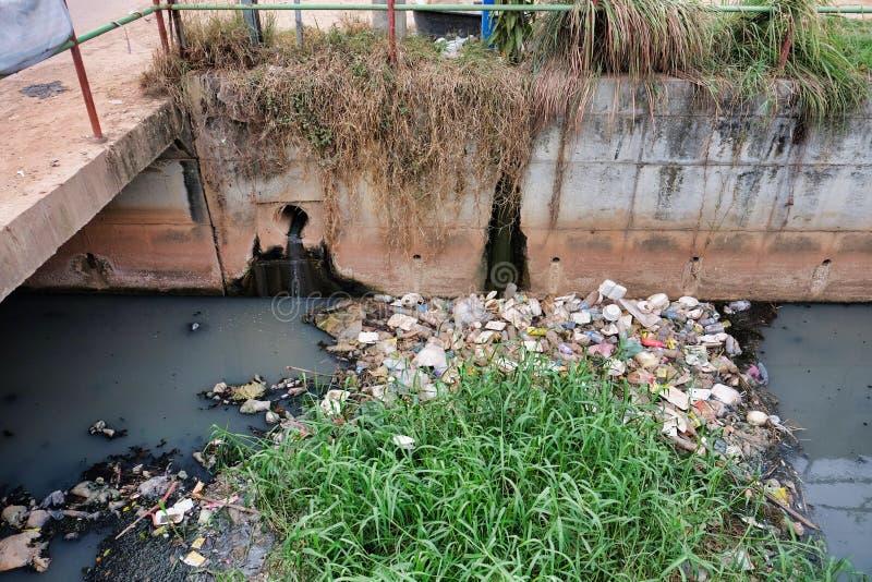 Cambodia, Siem Reap 12/08/2018 a garbage dump in a city water canal, a lot of garbage. Cambodia, Siem Reap 12/08/2018 a garbage dump in a city water canal, lot stock photos