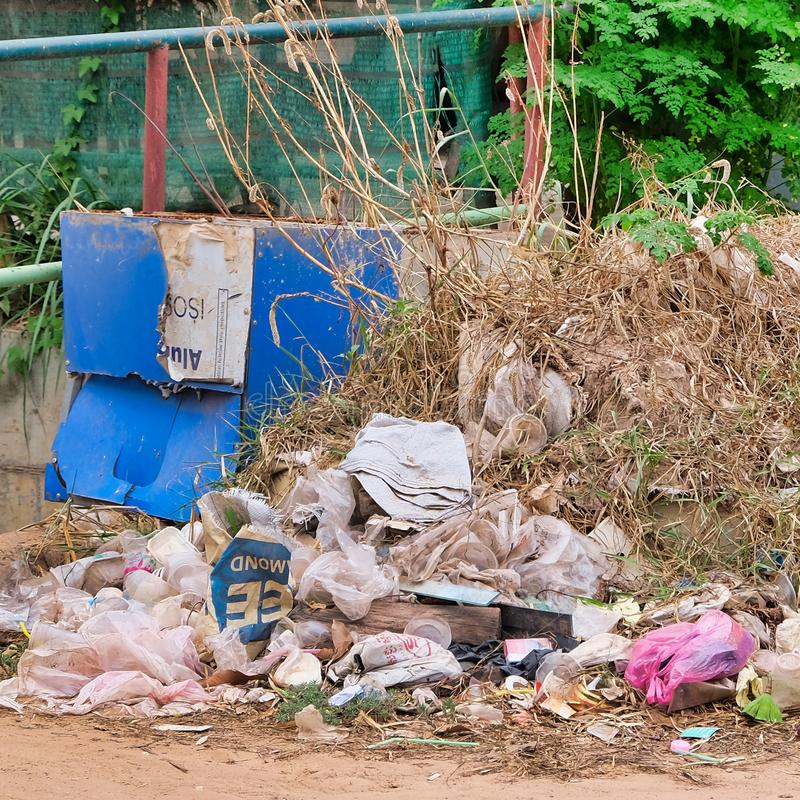 Cambodia, Siem Reap 12/08/2018 large pile of garbage on a city street, a lot of plastic bags and a blue cardboard box. Cambodia, Siem Reap 12/08/2018 a large stock photos