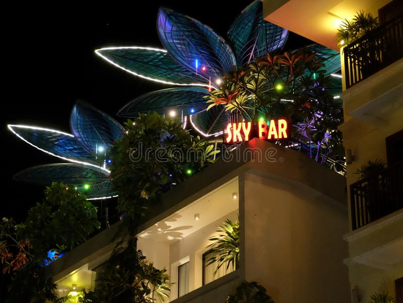 Night bar on the roof of the house, neon lights. Cambodia, Siem Reap 12/08/2018 night bar on the roof of the house, neon lights stock photo