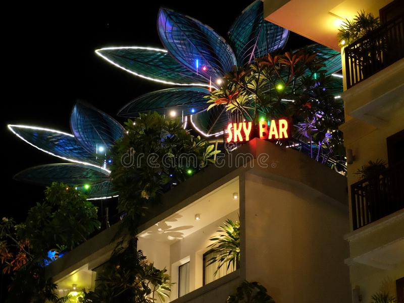 Night bar on the roof of the house, neon lights. Cambodia, Siem Reap 12/08/2018 night bar on the roof of the house, neon lights stock photography
