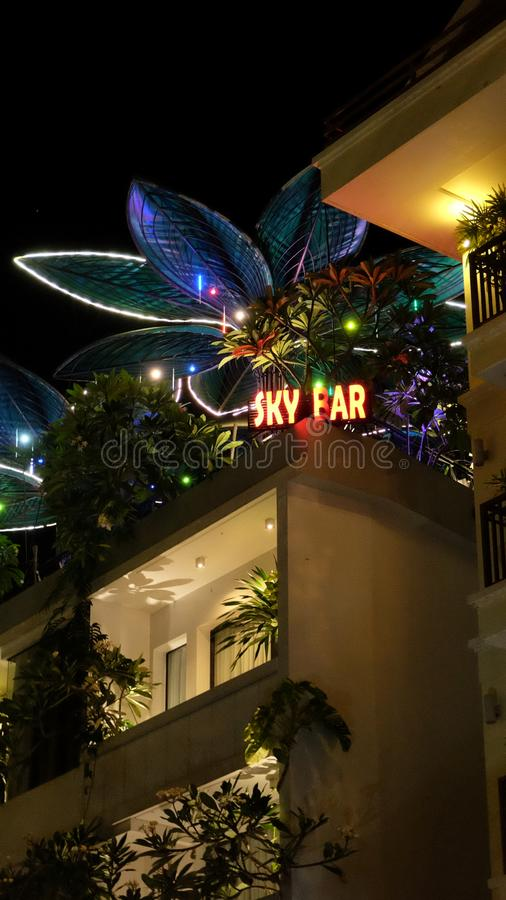 Night bar on the roof of the house, neon lights. Cambodia, Siem Reap 12/08/2018 night bar on the roof of the house, neon lights royalty free stock photos