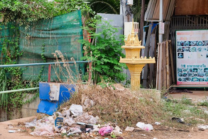 Cambodia, Siem Reap 12/08/2018 small Buddhist sanctuary among the heaps of garbage on a city street, a garbage dump near a. Cambodia, Siem Reap 12/08/2018 a royalty free stock photos
