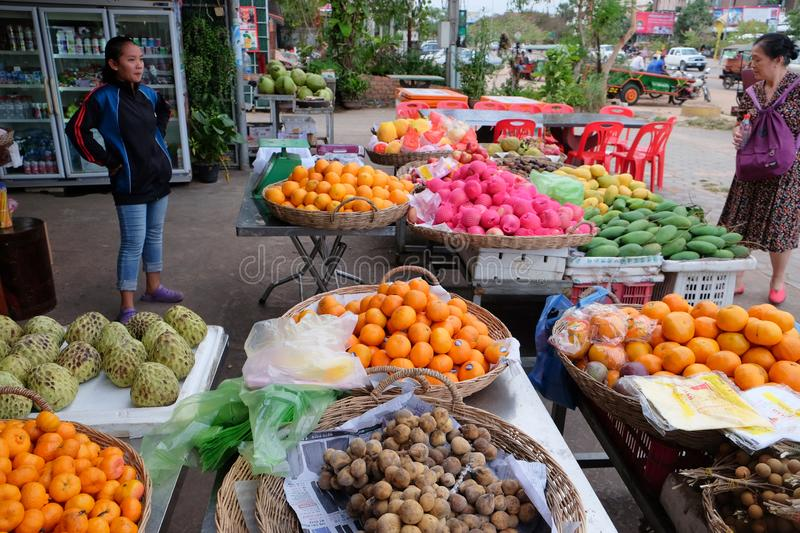 Cambodia, Siem Reap 12/08/2018 young Asian girl sells fruit on a city street. Cambodia, Siem Reap 12/08/2018 A young Asian girl sells fruit on a city street stock images