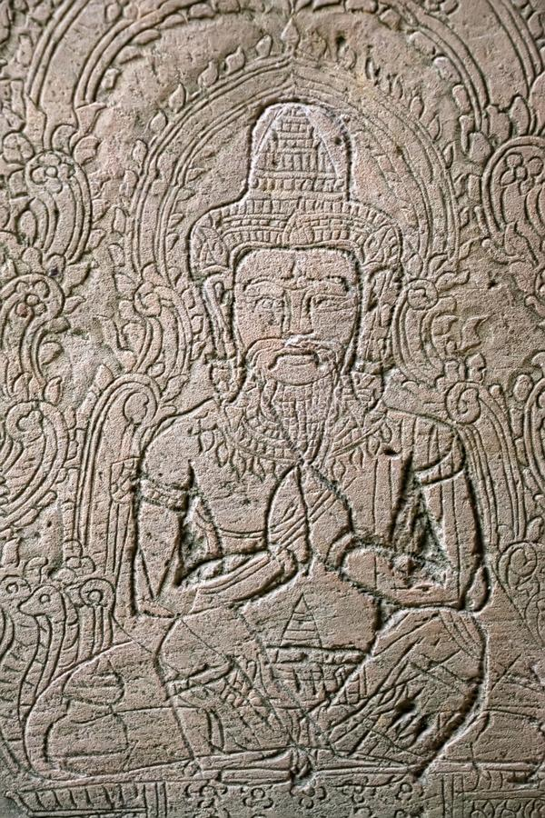 Carving in one of the ancient buildings at Ta Phrom.Many ruins h stock photography