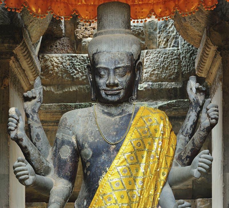 Cambodia; Wat de Angkor; Escultura de um Siva fotos de stock royalty free