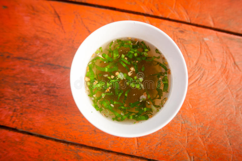 Cambodian broth with herbs. Hot cambodian broth. Traditional khmer style soup stock photo