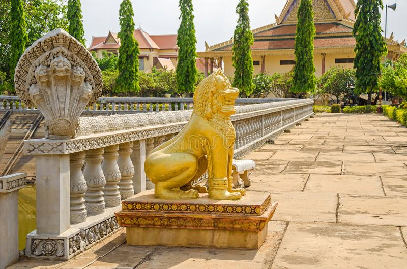 Cambodian five-headed naga and a lion as guardian statues in the. Cambodian five-headed naga and a lion, depicted as guardian statues at the entrance of the stock photography