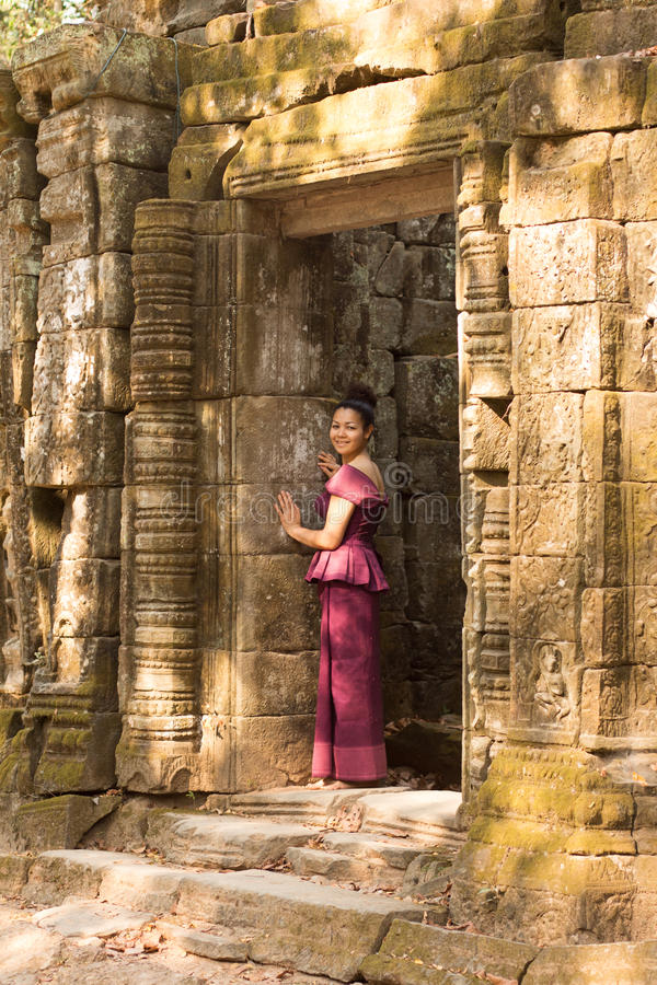 Cambodian Girl in Khmer Dress in Doorway of Ancient Building near Ta Prohm royalty free stock photos