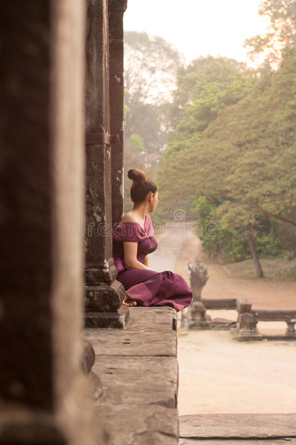 Cambodian Asian Girl in Traditional Dress at Angkor Wat Temple royalty free stock photography